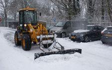 Loader met sneeuwschuif